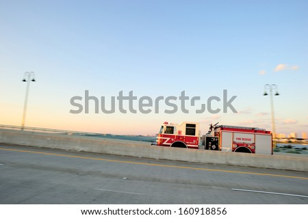 Fire rescue truck on the move, West Palm Beach, FL, USA - stock photo