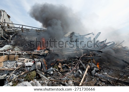Fire ruins of the building - stock photo