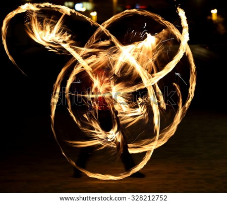 Fire show. Amazing fire performance in the night - stock photo