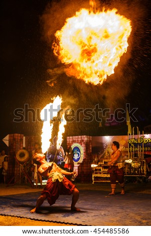"Fire show artist  in temple ""Wat Prathat Lampang Luang"" A respectable measure of traditional country Thailand, Lampang -July 18, 2016."