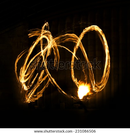 Fire Show Flaming Trails, Amazing Fire Show at night - stock photo