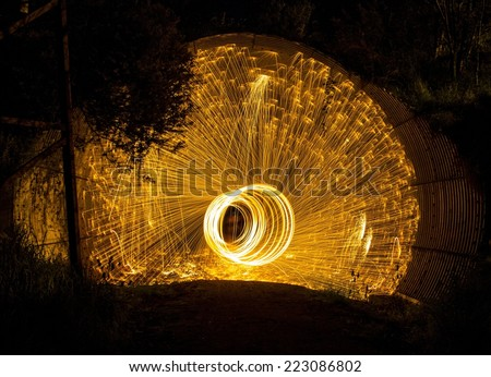 Fire Sparks Steel Wool Photography In Railway Tunnel