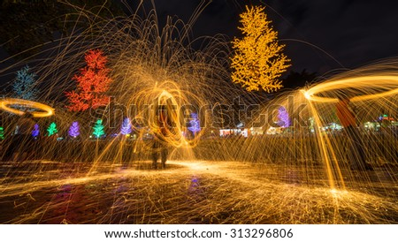 Fire spinning from steel wool during night scape activity at Ipoh, Perak, Malaysia.