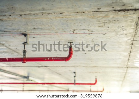 Fire sprinkler and red pipe  ( Filtered image processed vintage effect. ) - stock photo