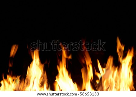 Fire tongues can be used for background - stock photo
