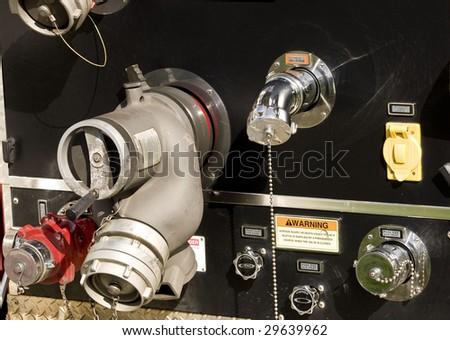 Fire truck hose connectors - stock photo