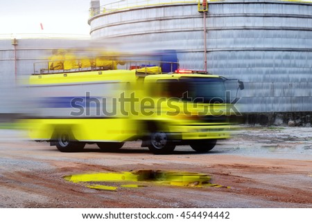 Fire truck, rescue  and background  storage tanks large at refinery oil plant . - stock photo