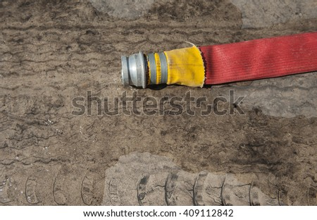 Fire trucks rubber hose water on the floor.  - stock photo