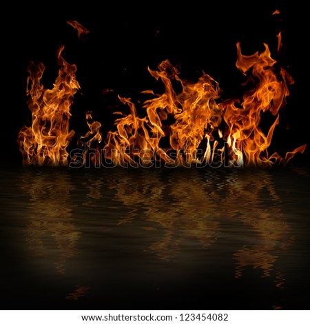 Fire with reflection in water on black background - stock photo