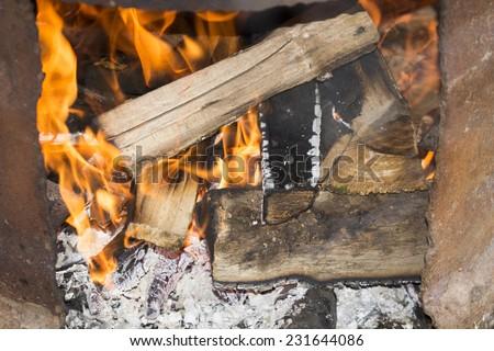Fire wood coal amber ash closeup - stock photo
