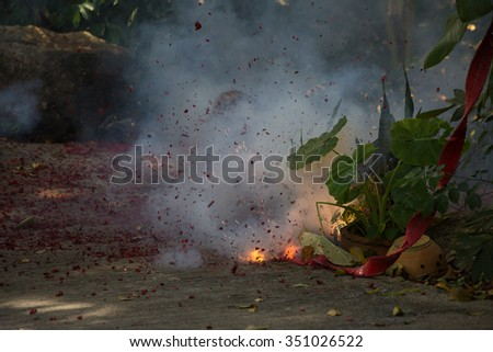 Firecrackers, burnt firecrackers lying on the street in Thailand - stock photo