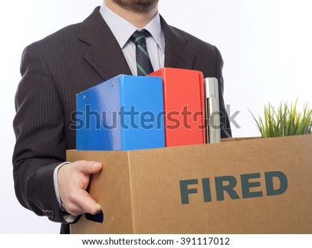 Fired businessman holding box with personal belongings isolated on white background. - stock photo