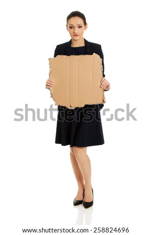 Fired businesswoman with piece of cardboard. - stock photo