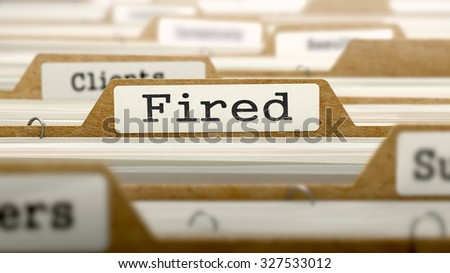 Fired Concept. Word on Folder Register of Card Index. Selective Focus.
