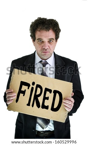 """Fired employee holding """"fired"""" sign in hand  - stock photo"""