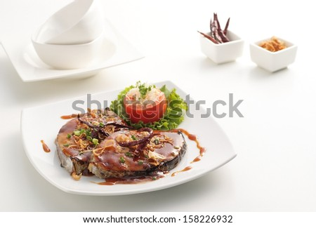 Fired mackerel with tamarind sauce on white back ground