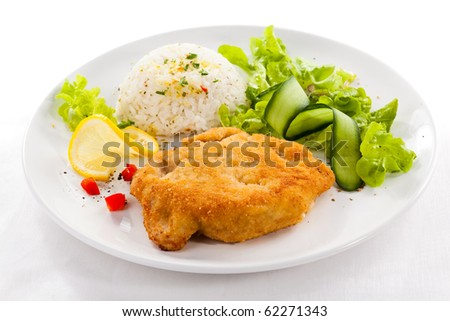 Fired meat, white rice and vegetables - stock photo