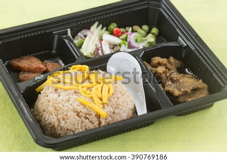 Fired Rice with shrimp paste include mango, egg,pork,dried shrimp,and red onions in Box set / Thai style food - stock photo