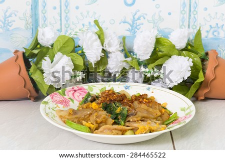 Fired thin noodles with soy sauce / Thai food - stock photo