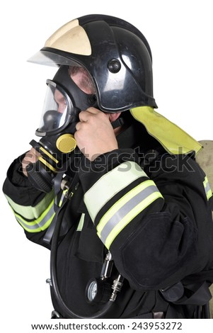 Firefighter corrects overview mask breathing apparatus. Isolated on white