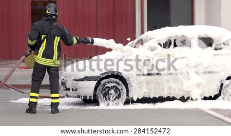 firefighter extinguished the fire with foam fighting - stock photo