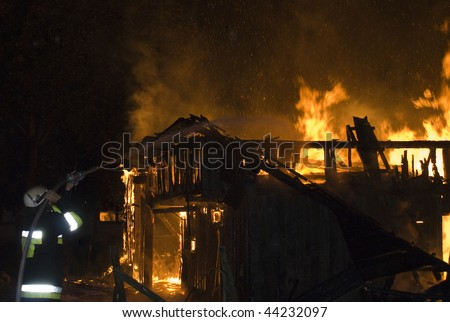 Firefighter extinguishes burning house