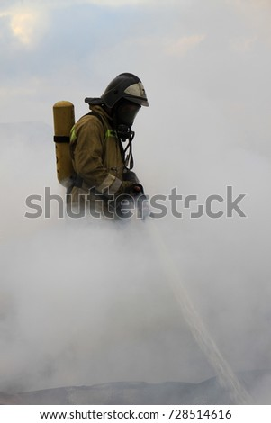 firefighter extinguishes fire in difficult conditions