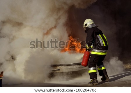 firefighter extinguishing a fire - stock photo