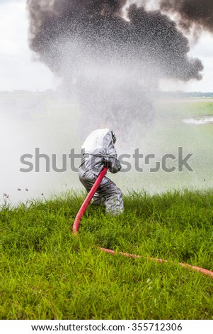 Firefighter fighting For A Fire Attack - stock photo