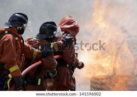 Firefighter fighting For A Fire Attack, During A Training