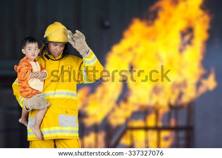 firefighter, fireman rescued the child from the fire - stock photo