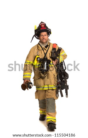 Firefighter holding mask and airpack fully protective suit walking on isolated white background