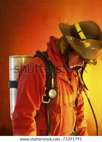 Firefighter in action. - stock photo
