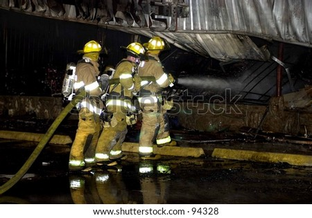 Firefighter putting out structure fire