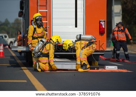 firefighter training with oxygen mask suit - stock photo