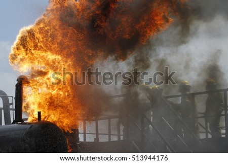 Firefighter try to put out the fire