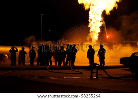 firefighter watching flames - stock photo