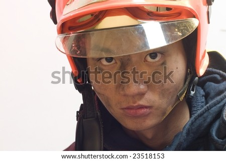 firefighter with a serious look on his face