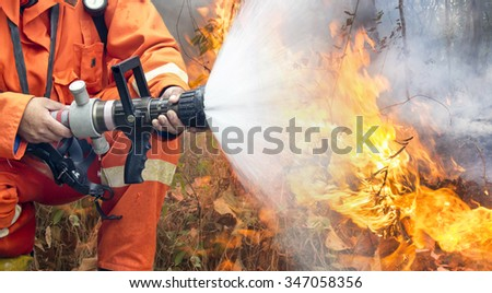 firefighters battle a wildfire - stock photo