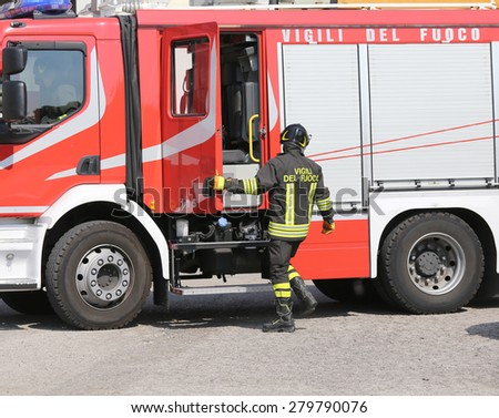 firefighters during an emergency with protective suits and helmets - stock photo