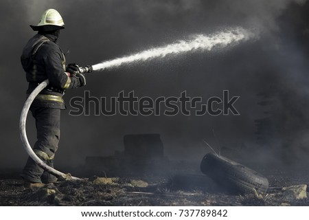 Firefighters extinguishing fire in building in the night