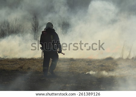 Firefighters fighting fire - stock photo