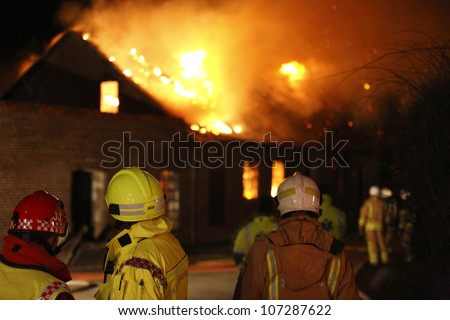 Firefighters in action during a burning building in Sweden. - stock photo