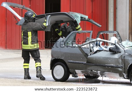 Firefighters open the hood of the car accident after accident