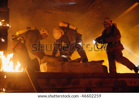 Firefighters rescue accident victim - stock photo