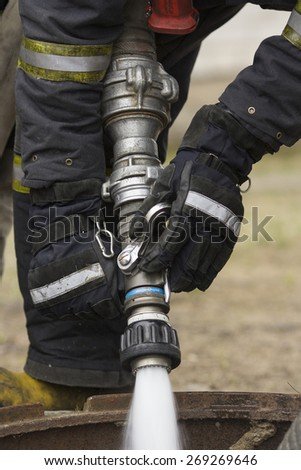 Firefighters spray water during a training exercise - stock photo