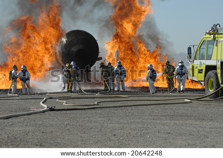 Firefighters train for battling an aircraft fire - stock photo
