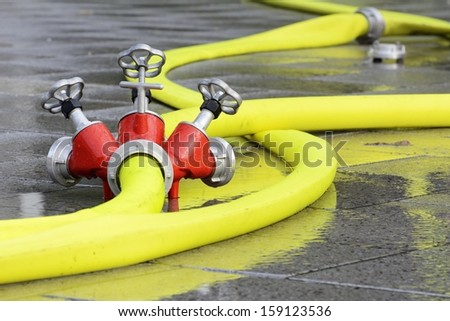 Firehose connected to a distribution device with faucet - stock photo