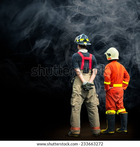 Fireman and rescue team standing in smoke background