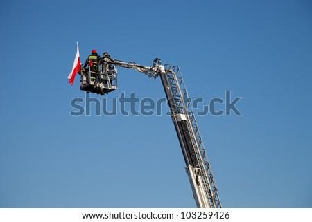 Fireman and women on Ladder Truck - stock photo